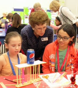 "Makayla Hunter, 10, from Brentwood Elementary School and Sophia Rivera, 12, from Venice Christian School worked together successfully on an engineering project, ""Tower Power"", where they built a straw tower that supported a soda can filled with rice. Carol Cudia, an AAUW member, coached them during their effort at the January 31 STEM Event sponsored by Venice-AAUW and the Frances T. Bourne Public Library."